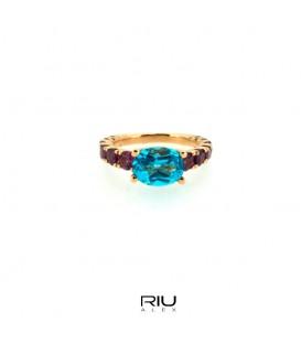 Anell or rosa 750/000 amb topazi blau i rodolita